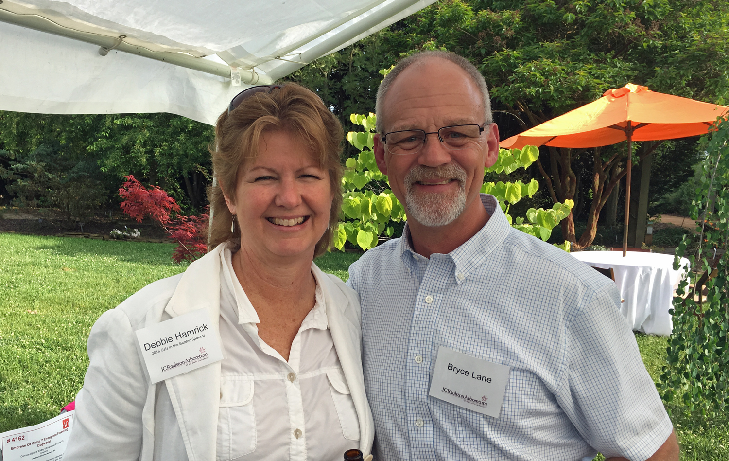 Debbie Hamrick and Bryce Lane enjoyed talking plants and perusing the auction tents.
