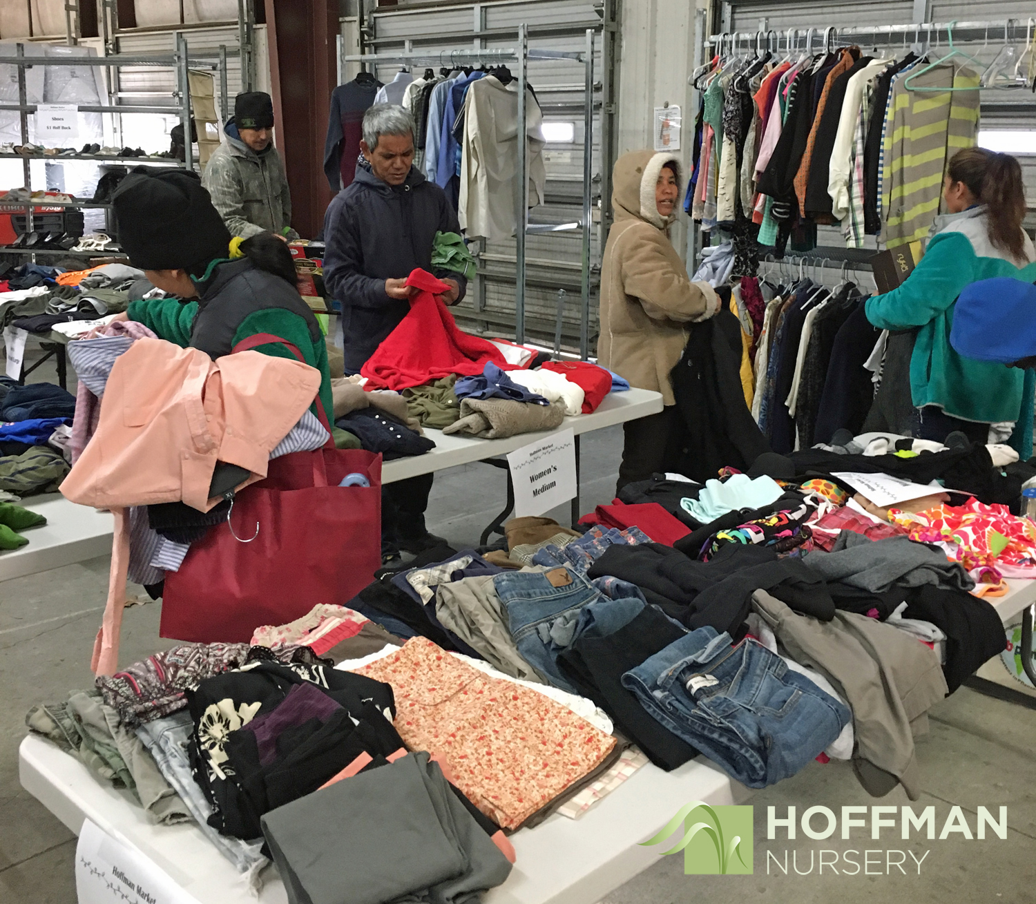 Tables and racks of clothing beckoned Hoffman Nursery shoppers.