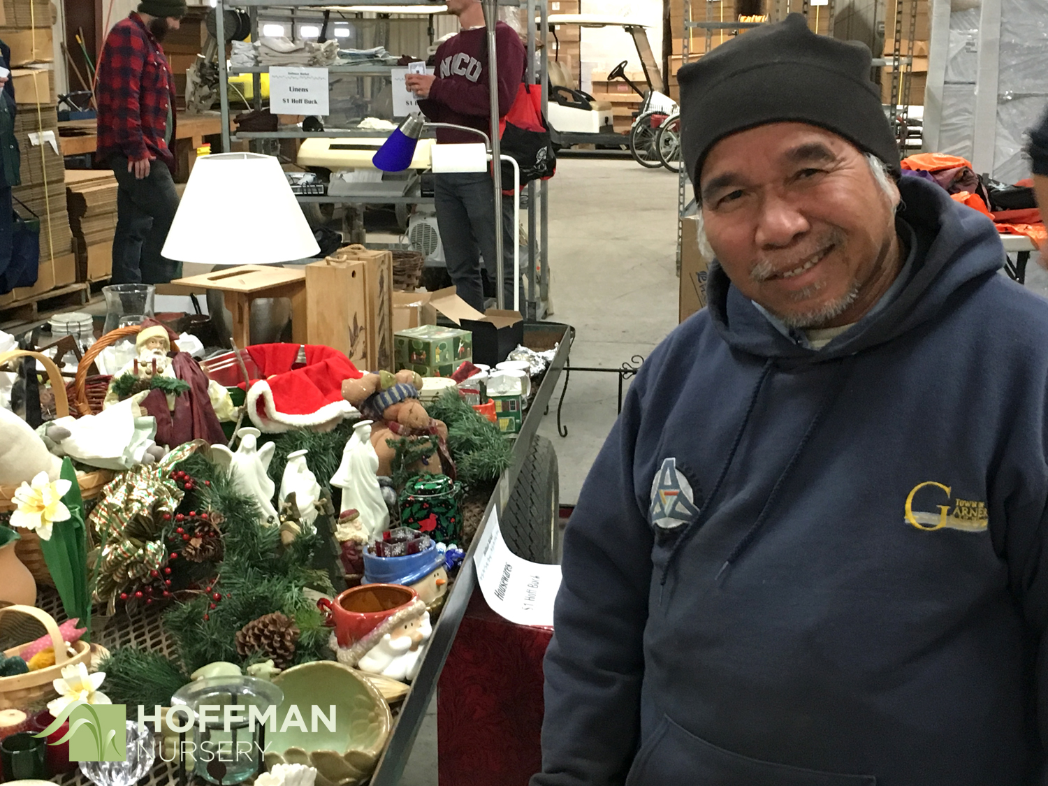 The kitchen and holiday items were by far the most eclectic. Hlin Ksor is ready to pick out his favorites.