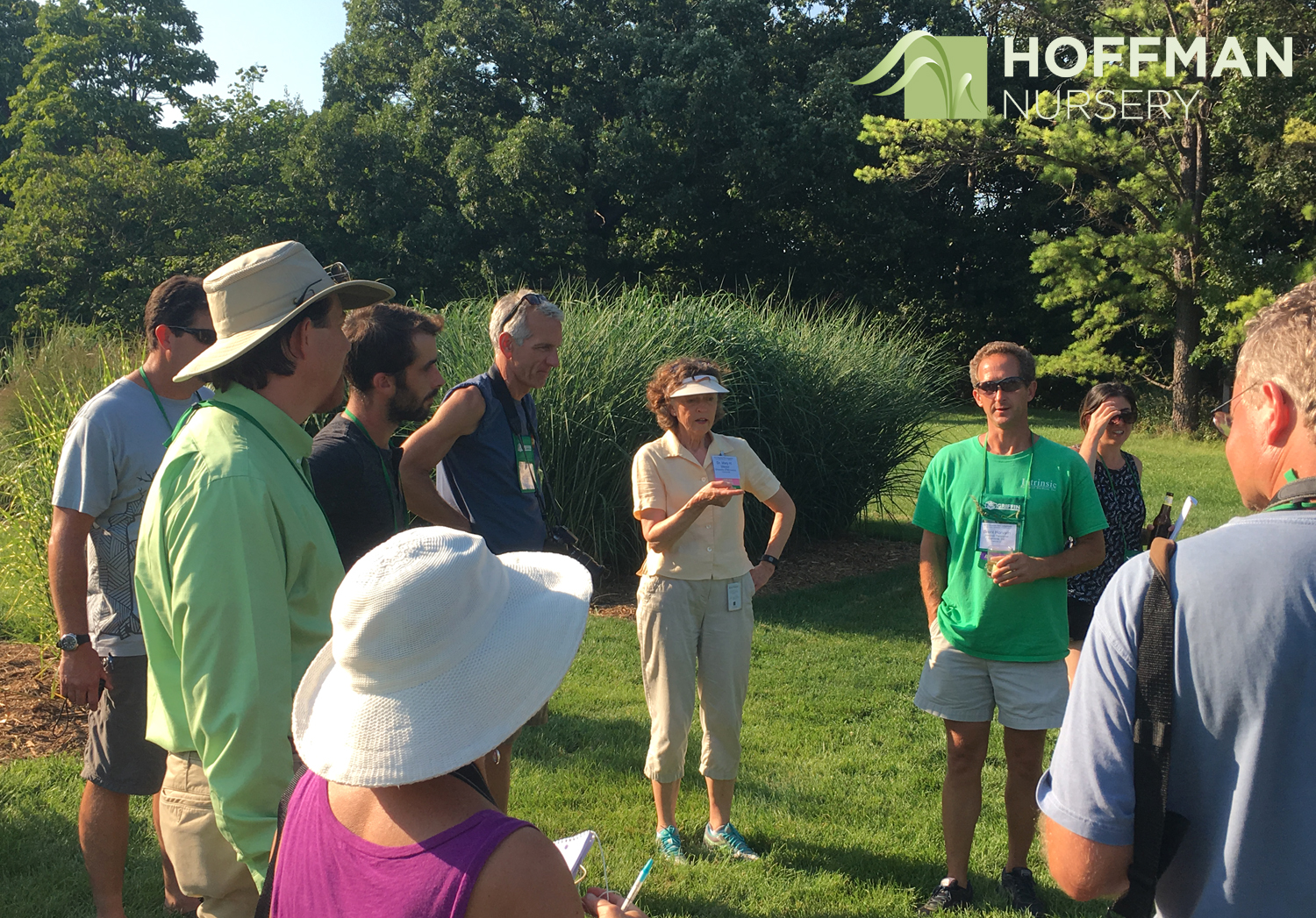 Dr. Mary Meyer, who oversees the grass collection, takes symposium attendees on a tour of the site.