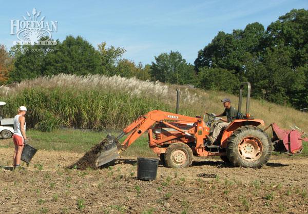 Depositing mulch for spreading
